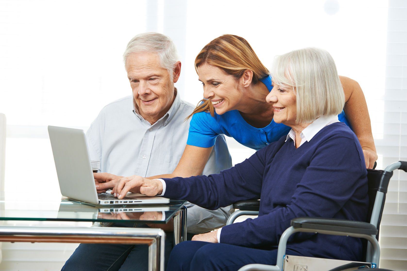 46991941 - smiling woman helping senior couple with laptop computer and the internet